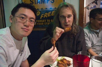 Taowei and Chris eating wings